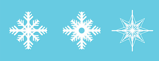 Winter snowflakes paper cutout on blue background