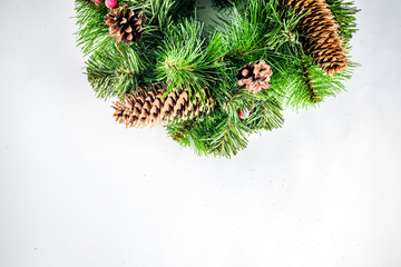 Christmas wreath with balls, pine cones, tree branches