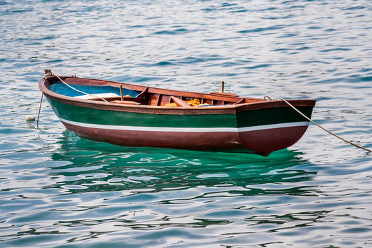 Empty rowing boat floating in the water.