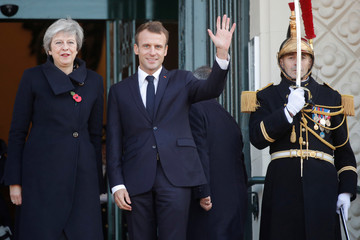French President Emmanuel Macron and Britain's Prime Minister Theresa May arrive for a meeting at the city hall in Albert