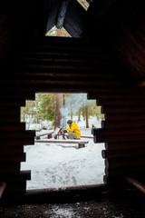 Finland, Kuopio, woman preparing campfire in winter