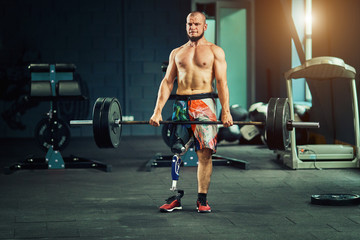 Sportsman with prosthesis working out in gym