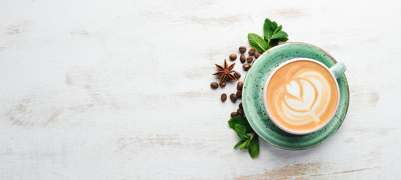 Cappuccino. Coffee with milk. On a white wooden background. Top view. Free copy space.