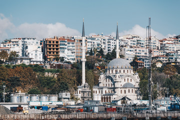 modern building and mosque - ancient technology and religion - november 2018 - istanbul turkey.