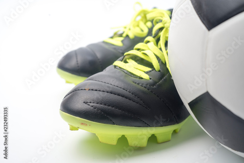 15de0822fb6 Football and a football shoes isolated on white background.