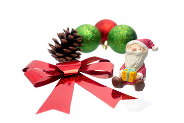 Santa Claus toy with Christmas ball isolated on white background