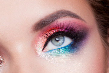 Bright eye makeup. Pink and blue color, colored eyeshadow.