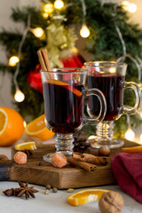Christmas red mulled wine in glass on wood board at white background