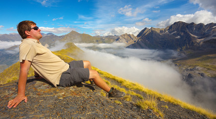 Resting tourist watching mountains on backround, Pyrenees