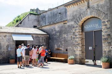 Visitors stand outside the Aquarium Pula