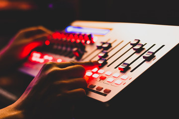 sound engineer, technician hands working on digital recording, broadcasting equipment in post production studio