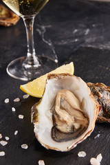 Oyster served with lemon and salt