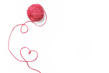 Red thread, heart and tangle on white background