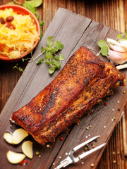 Rosted ribs with spices on wooden board
