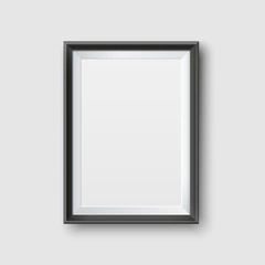 Realistic Empty Black Picture Frame Mockup. Realistic empty black picture frame, isolated on a neutral gray background.