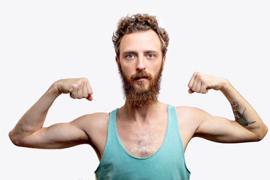 A funny mature bearded attractive guy with skinny torso, posing isolated over white studio background with raised folded hands