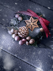 close up view of christmas and new year wreath on wooden back