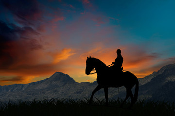 Papiers peints Equitation Silhouette of a horseman riding on horseback at sunset by mountains