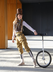 Pretty young lady in a fantasy clothes with unicycle