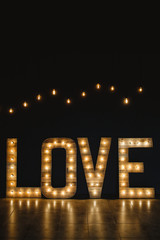 The word love wood with light.