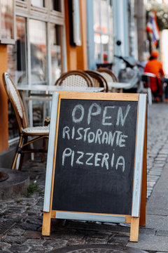 """Open"""""""" sign outside a Pizzeria"""