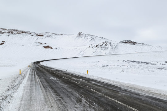 Winding road through wintery icelandic landscape