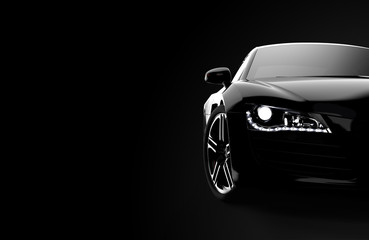 Front view of a generic and brandless modern black car on a dark background