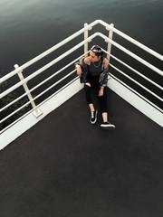 Stylish woman sitting at handrail