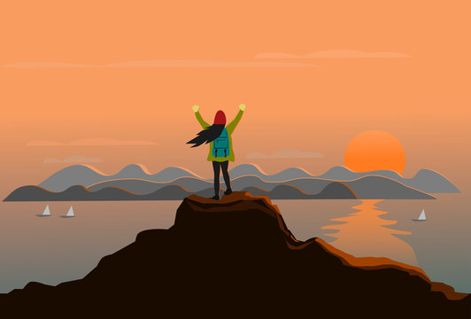 woman stands at the top of the mountain happily. There are sea, mountains and sunset background
