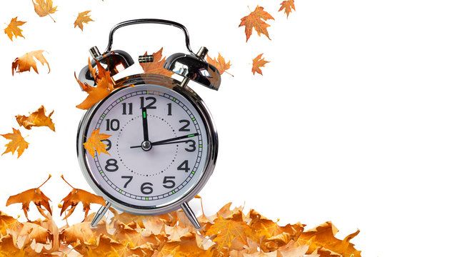 autumn time clock and leaves isolated for background