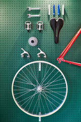Parts of bicycle stylishly mounted on wall