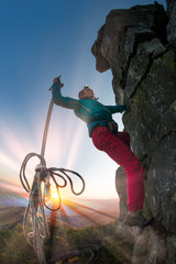 Climber at the top of the mountain at night.