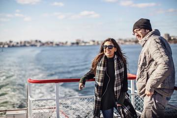Friends riding ferry, Portland, Maine, USA