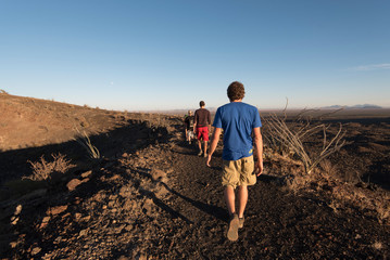 Group of people hiking on ridge of crater, Sonora, Mexico