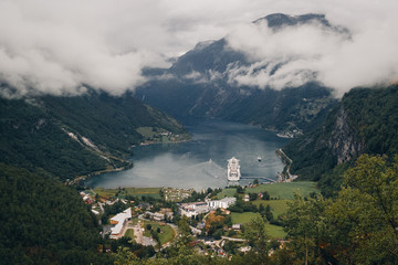 Village in fjord with cruise ship