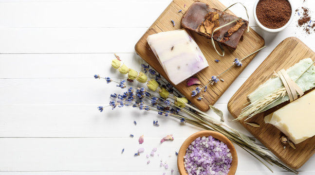 Handmade natural Soap with Dried lavender on a white wooden background