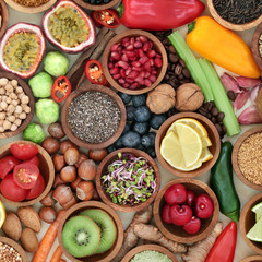 Health food for fitness  concept with fresh fruit, vegetables, grains, nuts, seeds, coffee, herbs and spices. High in antioxidants, anthocyanins, vitamins and dietary fibre.