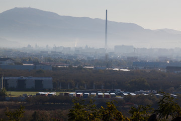 Fototapete - industrial town in early morning fog