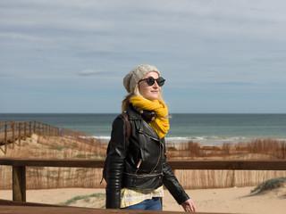 Stylish woman on boardwalk