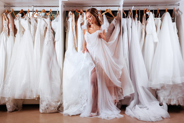 Female trying on wedding dress in a shop