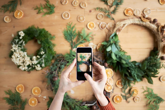 Photo of holiday wreaths on smartphone