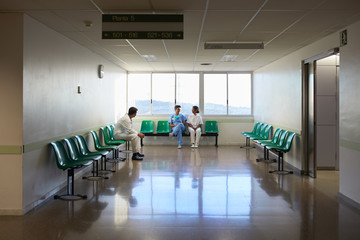 Hospital waiting room with staff sitting and relaxing