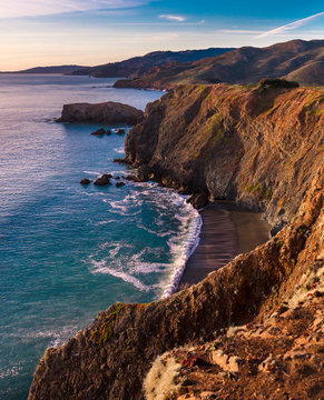 The warm tones of sunset on the cliffs of the Marin Headlands