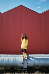 Girl in yellow on pipes