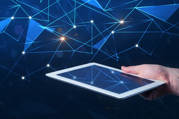 Man hand with tablet, network hologram