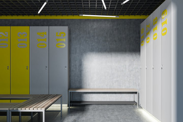Gray and yellow locker room interior, bench