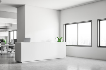 Corner of white office with reception