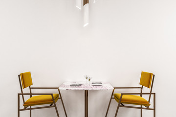 White restaurant, yellow chairs