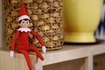Funny Christmas toy elf on shelf