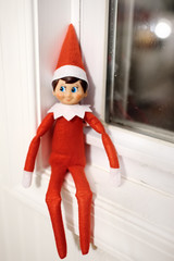 Funny Christmas toy elf on window